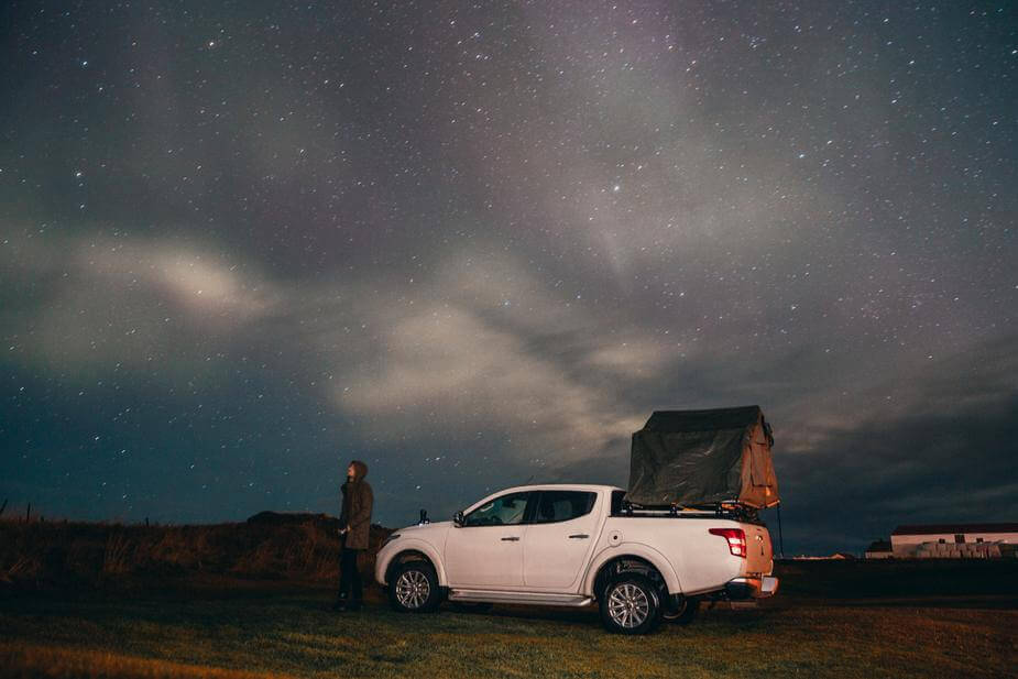 camping-under-stars-northern-lights_925x